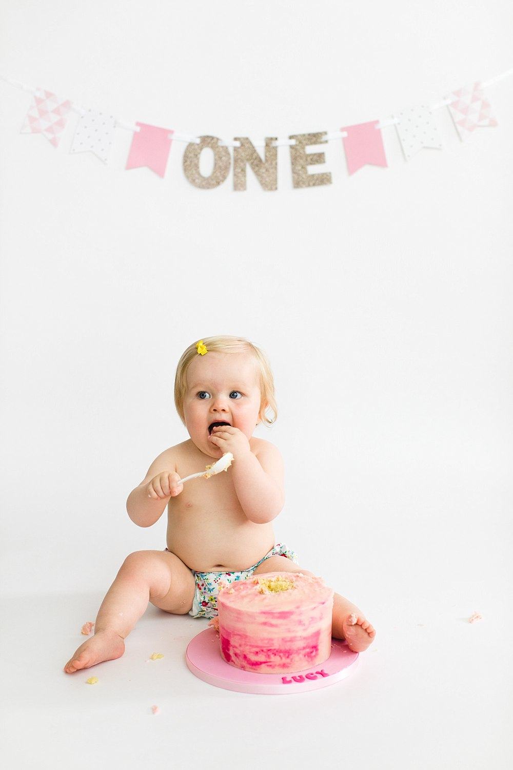 lucy cake smash one year old shoot_-25.jpg