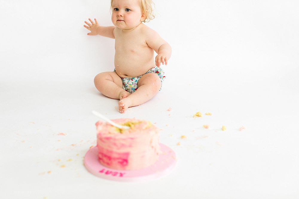lucy cake smash one year old shoot_-39.jpg