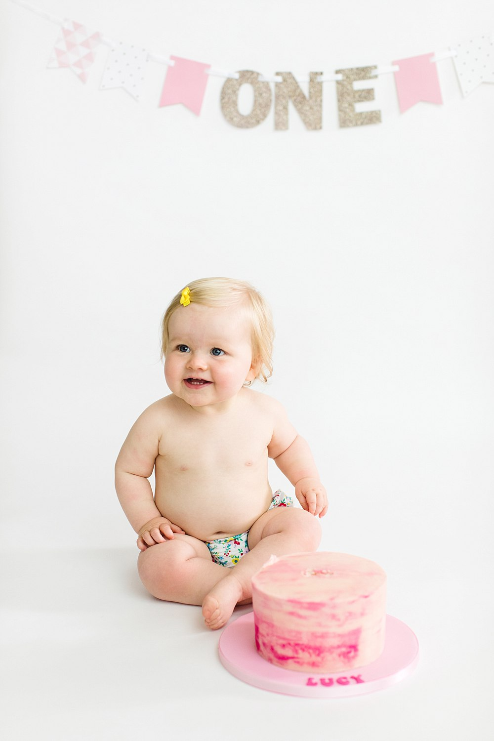 lucy cake smash one year old shoot_-7.jpg