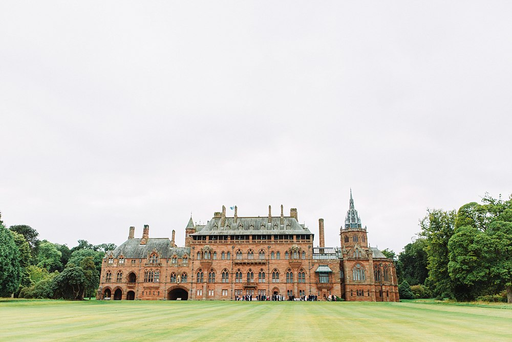 Venue shot of Mount Stuart while a wedding is on. Guests are enjoying the reception with drinks and canapes. Isle of Bute wedding, The Gibsons, ayrshire wedding photographer, colourful wedding photographers, elegant wedding photographers glasgow, light and bright wedding photographers scotland, mount stuart wedding, natural wedding photographers, romantic photographers Scotland