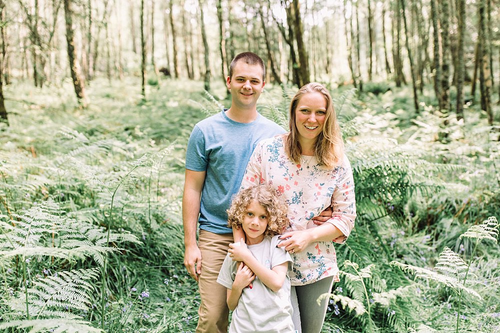 Family photo shoot in Balmaha, Loch Lomond with dad, mum and son. Light and bright and fun. Lots of greenery and outdoors. Wild, beach, trees, picnic, by the water